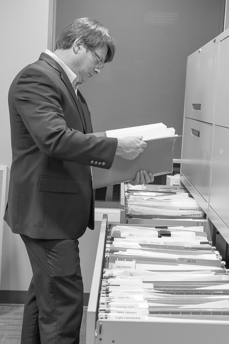 private investigator looking at files